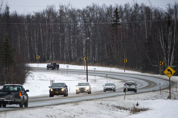 Traffic moves on Knik Goose Bay Road near West Fairview Loop on December 30, 2019. (Marc Lester / ADN)