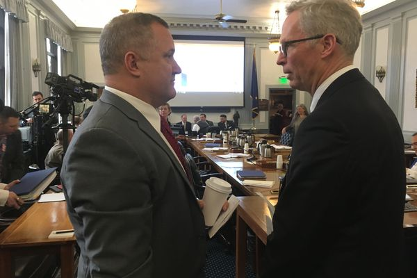 Sen. Mike Shower, R-Wasilla (left) talks with University of Alaska president Jim Johnsen, right, following a hearing of the Senate Finance Committee on Tuesday, Feb. 19, 2019. (James Brooks / ADN)