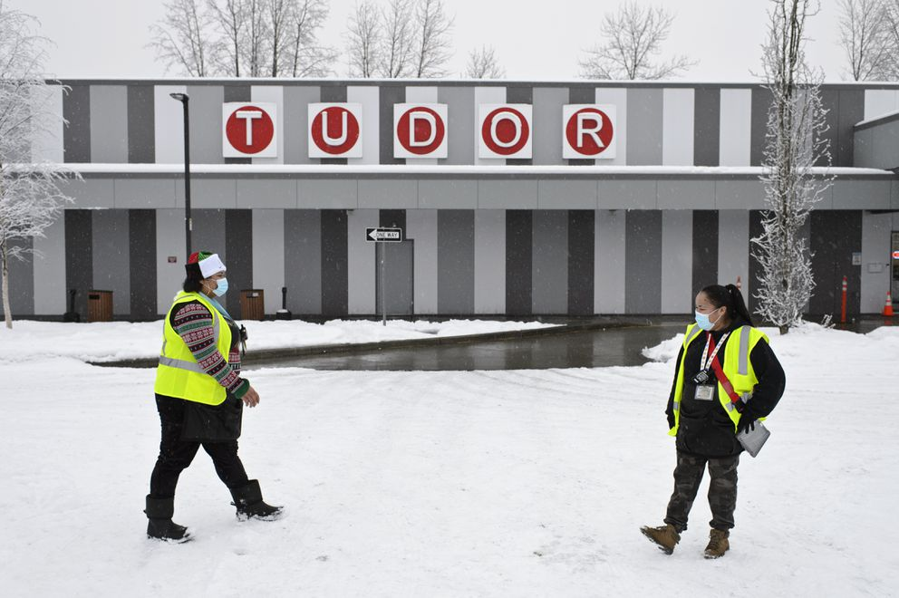 Gaming attendants Fiti Manu, left, and Ester McGinty talk as they work in the Tudor Bingo Center parking lot on December 8, 2020. (Marc Lester / ADN)