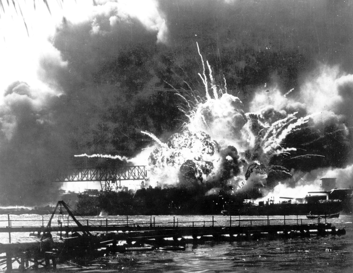In this Dec. 7, 1941 file photo provided by the U.S. Navy, the destroyer USS Shaw explodes after being hit by bombs during the Japanese attack on Pearl Harbor, Hawaii. About 20 survivors are gathering on Friday, Dec. 7, 2018, at Pearl Harbor to remember thousands of men lost in the Japanese attack 77 years ago. The youngest of the survivors is in his mid-90s. The Navy and National Park Service will jointly host the remembrance ceremony Friday at a grassy site overlooking the water and the USS Arizona Memorial. (U.S. Navy via AP, File)