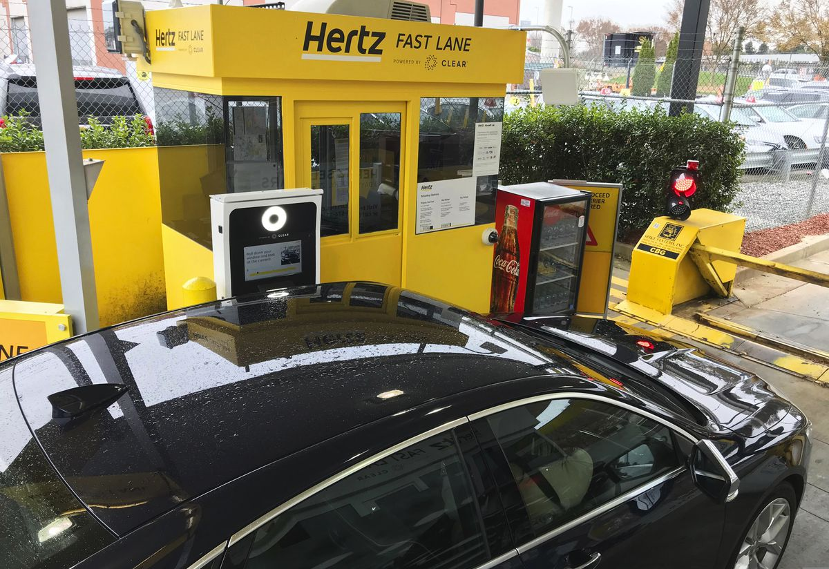 In this Friday, Dec. 7, 2018, photo, a rental car approaches a biometric scanning machine at the exit of the Hertz facility at Hartsfield-Jackson Atlanta International Airport, in Atlanta. (AP Photo/Jeff Martin)