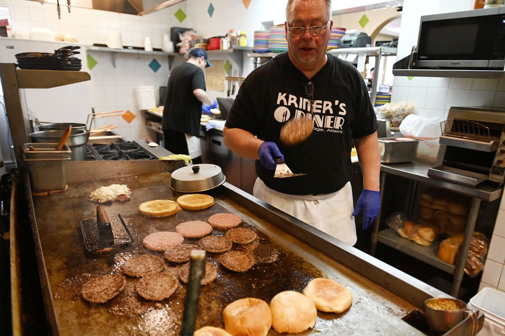 Andy Kriner flips a Deuce Burger at Kriner's Diner on Tuesday, March 24, 2020. (Bill Roth / ADN)