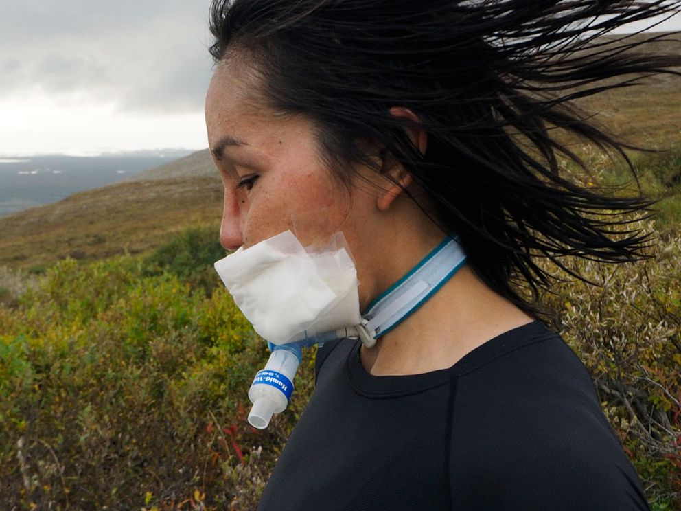 Carol Seppilu runs a dirt road from Anvil Mountain back toward Nome during a training run on August 31, 2019. (Marc Lester / ADN)
