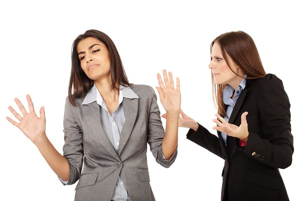 Portrait of two businesswomen having an argument isolated on white background. (Thinkstock)