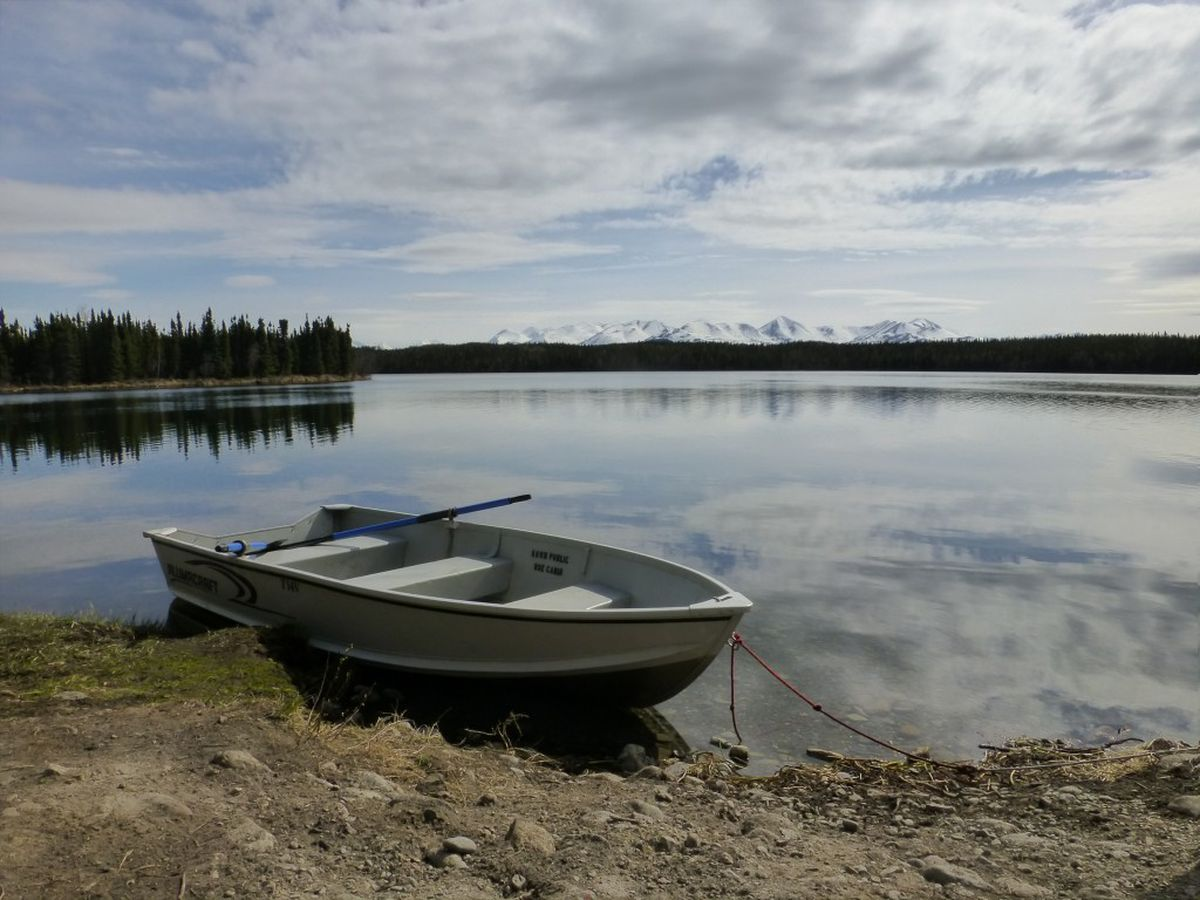 A rowboat rests on the beach near the Kelly Lake cabin on the Seven Lakes Trail in the Kenai National Wildlife Refuge. (Lisa Maloney)