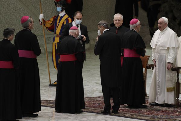 """Pope Francis, right, greets bishops at the end of his weekly general audience in the Paul VI hall at the Vatican, Wednesday, Oct. 21, 2020. Pope Francis endorsed same-sex civil unions for the first time as pope while being interviewed for the feature-length documentary """"Francesco,"""" which premiered Wednesday at the Rome Film Festival. (AP Photo/Gregorio Borgia)"""