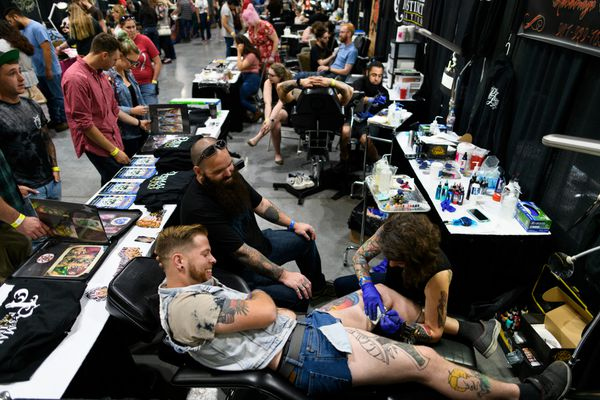 Austin Pyle, of Anchorage, gets a tattoo from Danielle White of Primal Instinct Tattoo. (Marc Lester / ADN)