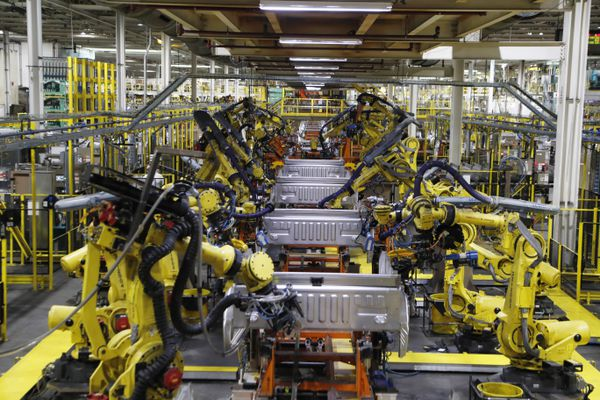 Robots weld the bed of a 2018 Ford F-150 truck on the assembly line at the Ford Rouge assembly plant, Thursday, Sept. 27, 2018, in Dearborn, Mich. (AP Photo/Carlos Osorio)