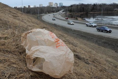 A plastic bag tumbles in the wind on the Hillcrest Drive offramp as motorists travel along Minnesota Drive on Tuesday, April 26, 2017. Saturday kicks off the 49th annual Citywide Cleanup Week though May 6. Groups can register at CitywideCleanup.org and arrange for the number of garbage bags needed with the Anchorage Chamber of Commerce. Individuals are also invited to go to any of the Fred Meyer stores' customer service counters in Anchorage and Eagle River to pick up Citywide Cleanup bags (2 per person). The Municipality of Anchorage Solid Waste Services will offer free dump days Saturday and Saturday, May 6, at the Anchorage Regional Landfill at 1550 E. Eagle River Loop Road, Eagle River, as well as at the Girdwood Transfer Station. The Anchorage Regional Landfill Central Transfer Station will be closed on those Saturdays. (Bill Roth / Alaska Dispatch News)