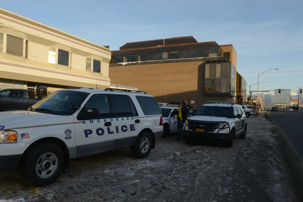 Anchorage police officers investigate a shooting at Determine Design at 903 W. Northern Lights Blvd. in Anchorage on Wednesday, Nov. 15, 2017. (Bob Hallinen / Alaska Dispatch News)