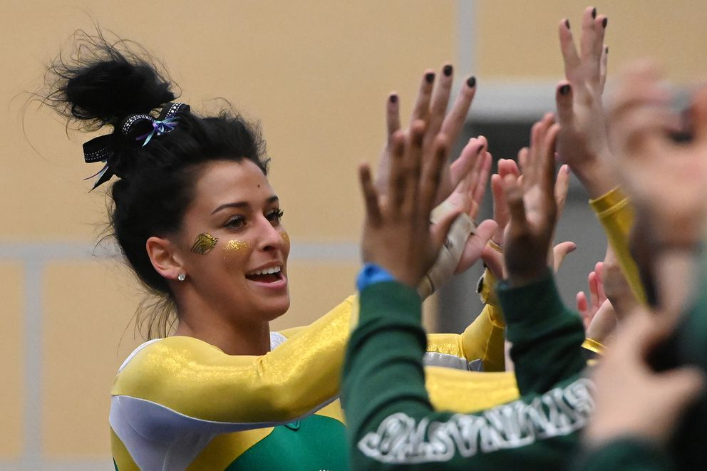 UAA freshman Kenadi Bown celebrates with teammates after competing on the floor exercise during the Seawolves dual-meet loss to Southeast Missouri State at the Alaska Airlines Center on Sunday, Jan. 12, 2020. (Bill Roth / ADN)