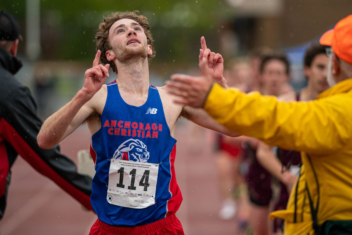 Anchorage Christian runner Tristian Merchant points to the sky after breaking the state record in the 3,200 meters Friday at the state track and field championships at Dimond High. (Loren Holmes / ADN)