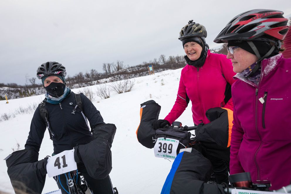 From left, Kaitlin Mattos, Gloria Menzel and Bonnie Wanat pause at the finish line of the 25-mile race. (Loren Holmes / ADN)