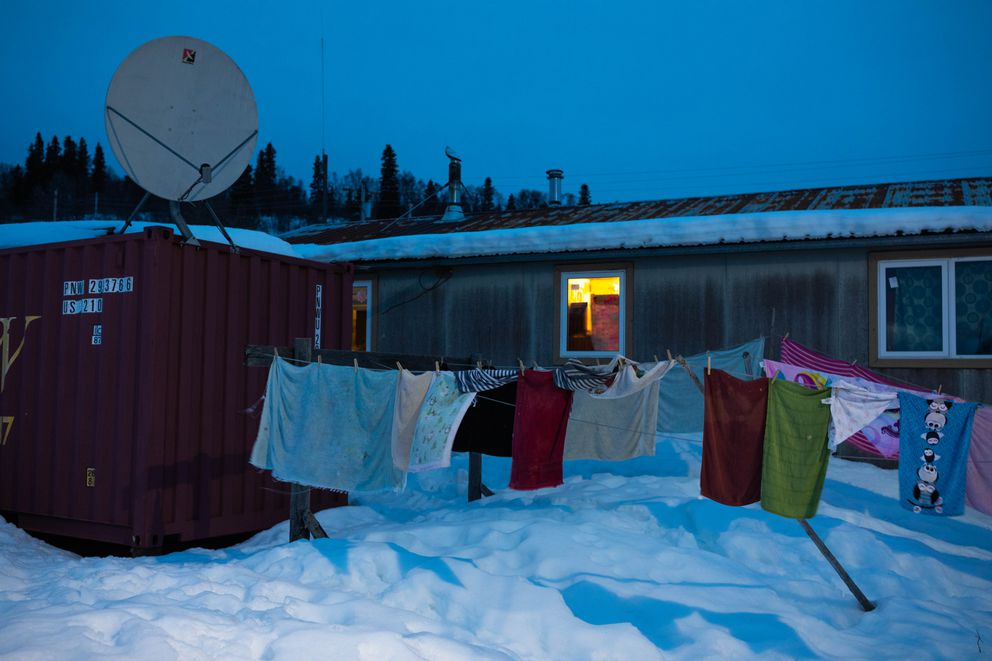 Clothes dry outside a home in March. (Loren Holmes / ADN)