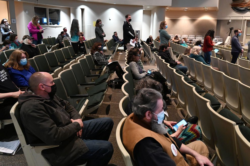 People wait in line to testify during the Anchorage Assembly meeting on Tuesday, April 13, 2021. (Bill Roth / ADN)