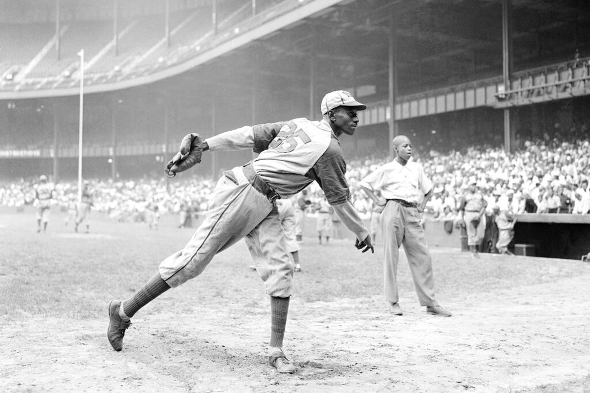 In this Aug. 2, 1942, photo, Kansas City Monarchs pitcher Leroy Satchel Paige warms up at New York's Yankee Stadium before a Negro League game between the Monarchs and the New York Cuban Stars. Major League Baseball has reclassified the Negro Leagues as a major league and will count the statistics and records of its 3,400 players as part of its history. (AP Photo/Matty Zimmerman, File)