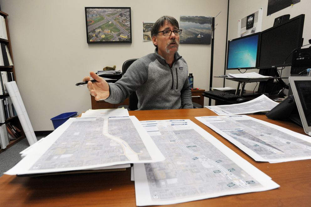 Alaska Department of Transportation and Public Facilities project manager Sean Holland with concept plans on Monday, Nov. 19, 2018, for reducing traffic congestion on the Seward Highway in Midtown. (Bill Roth / ADN)