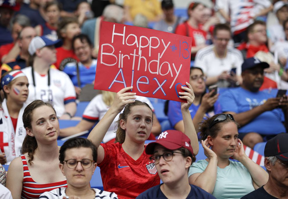 A United States's fan holds a birthday wish banner for United States' Alex Morgan before the Women's World Cup semifinal soccer match between England and the United States, at the Stade de Lyon, outside Lyon, France, Tuesday, July 2, 2019. (AP Photo/Alessandra Tarantino)