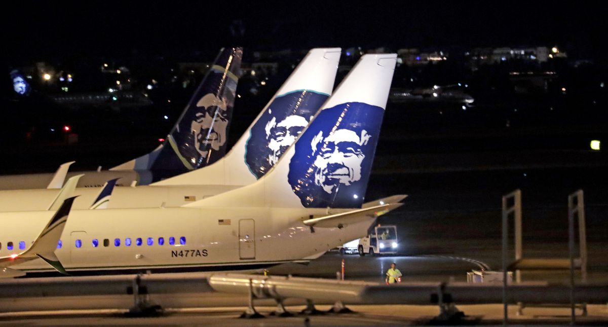 Alaska Airlines planes sit on the tarmac at Sea-Tac International Airport. (AP file photo/Elaine Thompson)