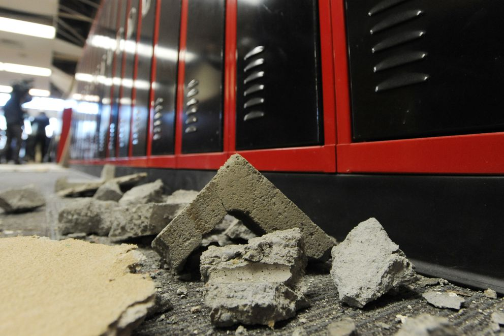 Crumbled concrete cinder blocks came to rest near hallway lockers at Houston Middle School on Monday, Dec. 3. 2018. (Bill Roth / ADN)
