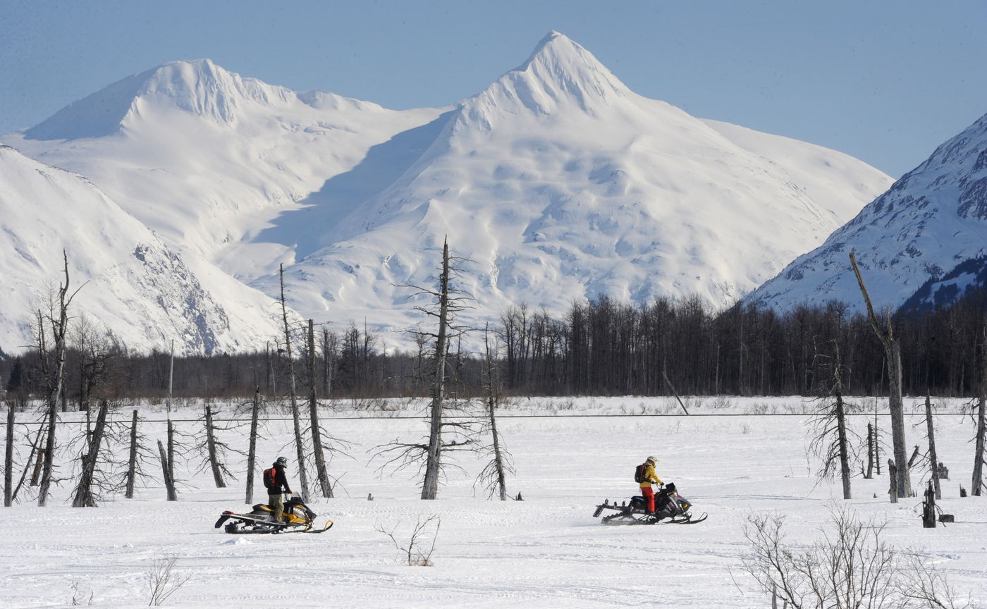 MARCH 30. Snowmobilers ride across hard-packed snow near Portage. (Bill Roth / ADN)