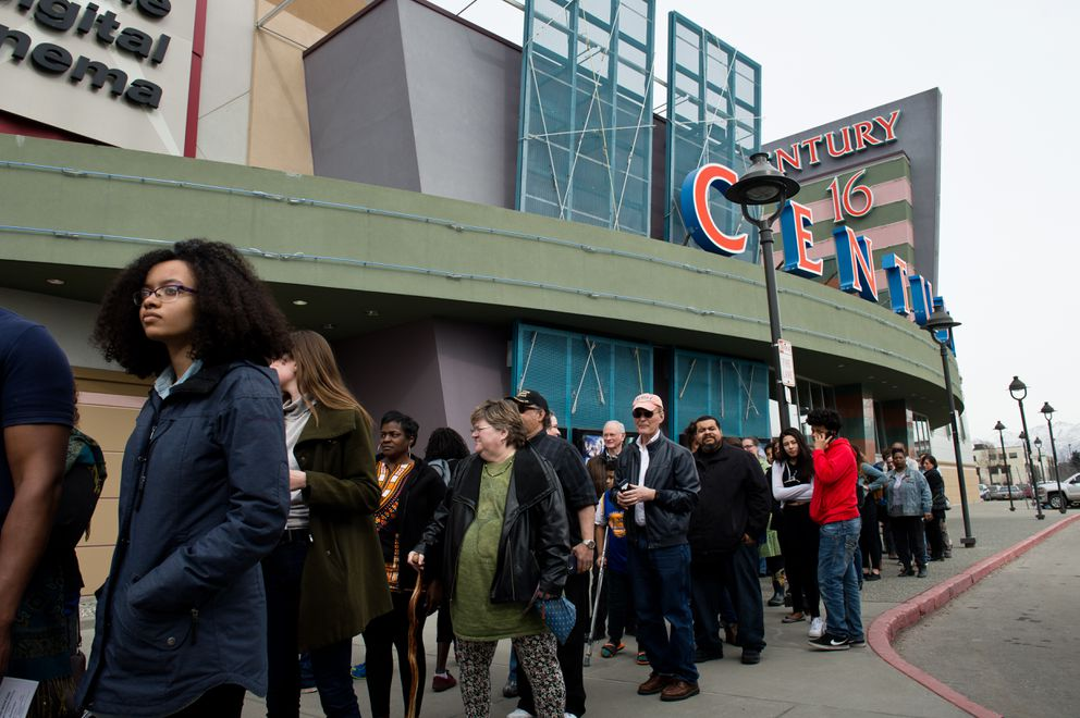 Chaperones line up to greet kids to escort to the movie in front of the theater. (Marc Lester / ADN)