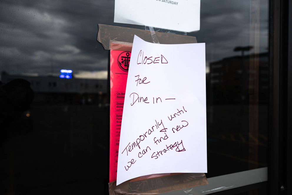 A sign that says 'Closed for dine in - temporarily until we can find a new strategy, ' is posted on top of a stop work order on Saturday, Aug. 8, 2020 at Wings 'N Things. (Loren Holmes / ADN)