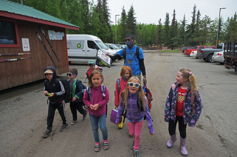 Kids at Camp Fire summer camp get ready for a hike in June 2021. Camp Fire is struggling to hire child care workers. This summer, it's programs are operating at 60% capacity because there aren't enough workers. And this school year, it'll be less than that. (Matthew Faubion/Alaska Public Media)