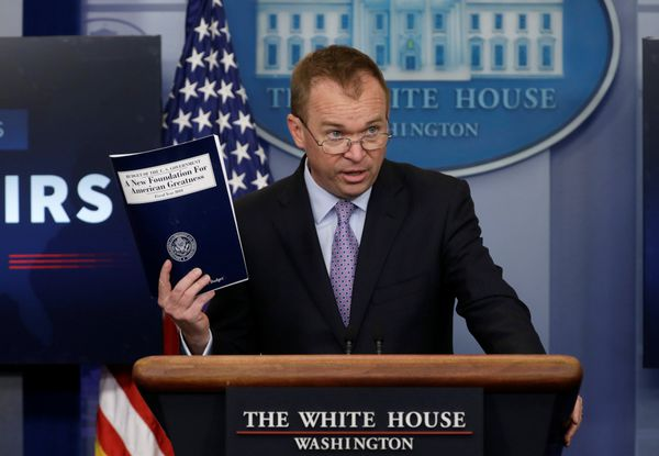 Office of Management and Budget Director Mick Mulvaney holds President Trump's FY2018 proposed budget Tuesday at the White House. REUTERS / Jim Bourg