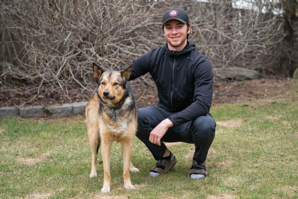 Jeremy Swayman, photographed with his dog Jade in Anchorage on Friday, May 8, 2020. Swayman was the top college goalie of the year while at the University of Maine and is leaving after his junior year to go pro with the Boston Bruins. (Loren Holmes / ADN)