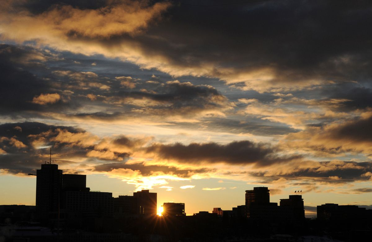 The setting sun slips past the Anchorage skyline on Thursday afternoon, Dec. 12, 2019. Winter Solstice, the shortest day of the year, occurs on Saturday, Dec. 21. (Bill Roth / ADN)