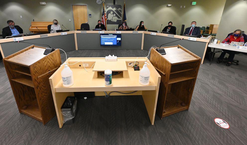 Anchorage School Board members listen to telephonic public testimony on an ASD Anti-Racism policy during the Anchorage School Board meeting on Tuesday, April 20, 2021. (Bill Roth / ADN)