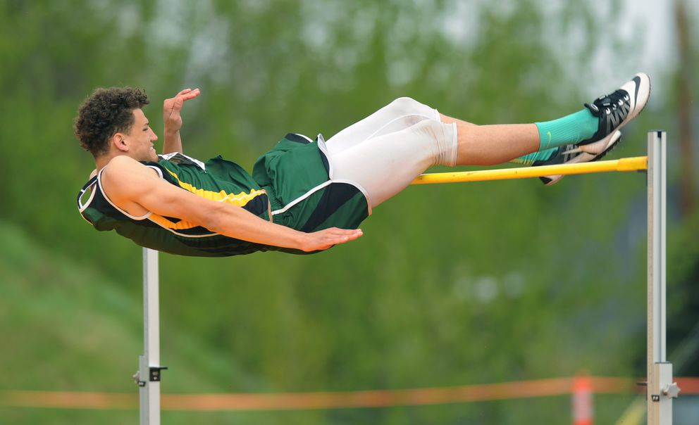 Nathan Fromm of Service clears 6-2 to win the boys high jump. (Erik Hill / Alaska Dispatch News)