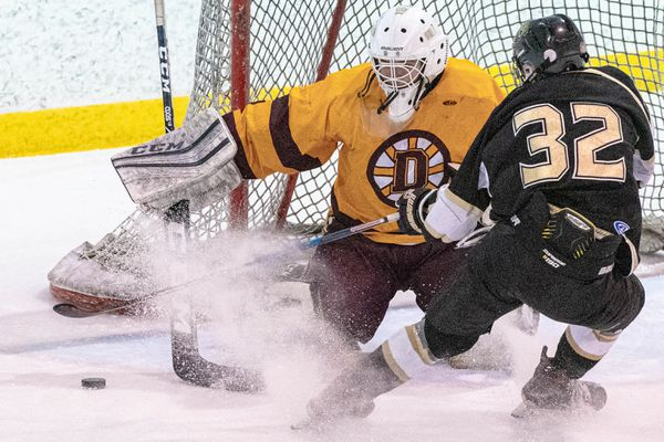 Dimond goaltender Gage Guay deflects a shot from South's Bryston Monrean during the Cook Inlet Conference championship hockey game at Ben Boeke arena on Saturday, May 8, 2021 in Anchorage. (Loren Holmes / ADN)