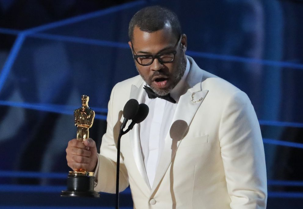 "Jordan Peele accepts the Oscar for Best Original Screenplay for ""Get Out."" REUTERS/Lucas Jackson"