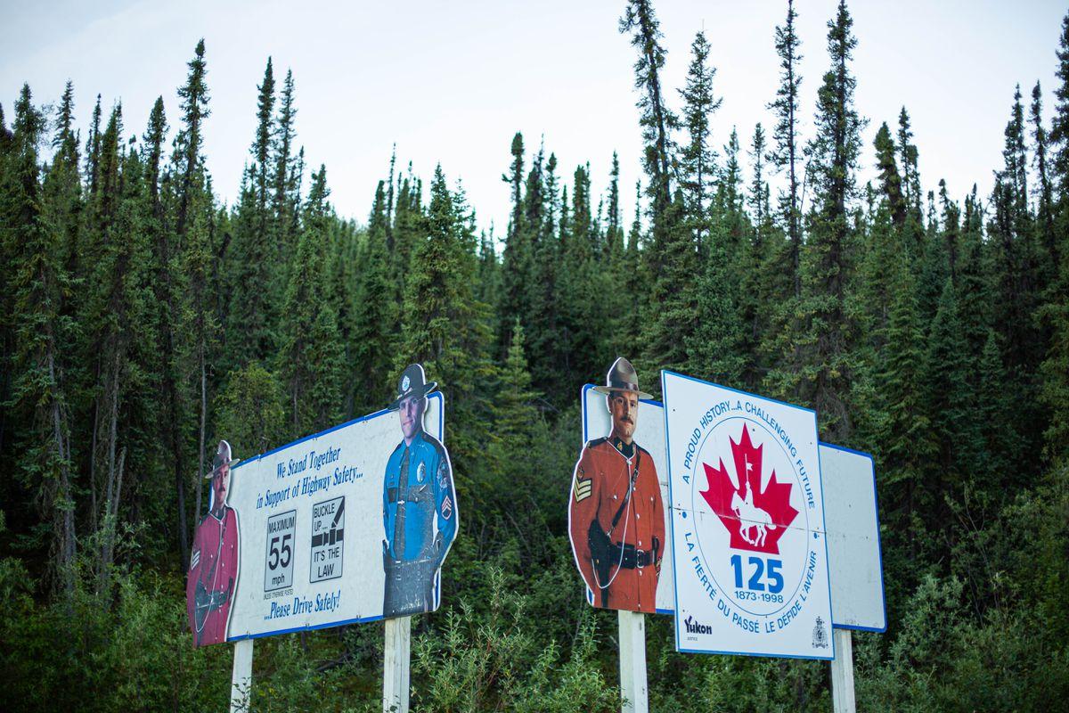Road signs in Alaska near the United States-Canada border. (Loren Holmes / ADN archive)