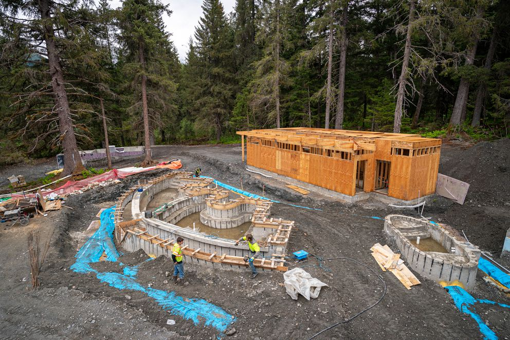 Construction workers build outdoor tubs at the Alyeska Nordic Spa on Thursday, June 10, 2021 at Alyeska Resort in Girdwood. The new spa is planned to open this fall. (Loren Holmes / ADN)