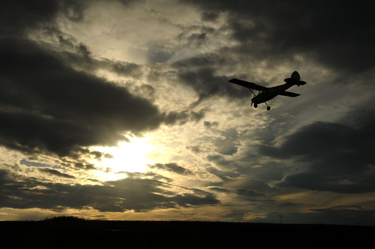 Small planes land at Merrill Field in Anchorage against the setting sun on Thursday, June 20, 2013. (Bob Hallinen / ADN Archive)