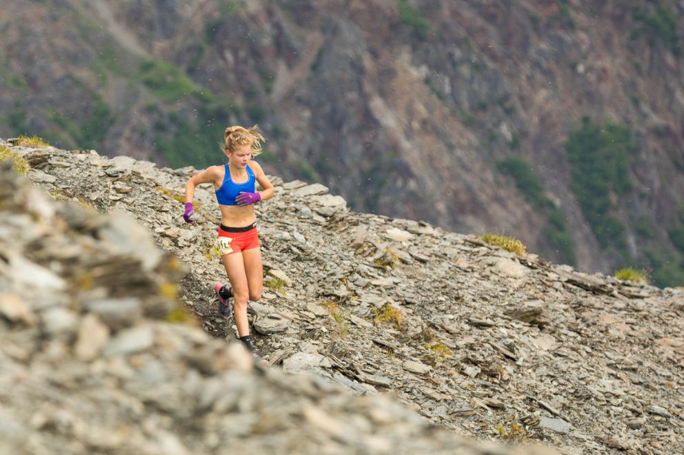 Allie Ostrander begins her descent of Mount Marathon on Tuesday. (Loren Holmes / Alaska Dispatch News)