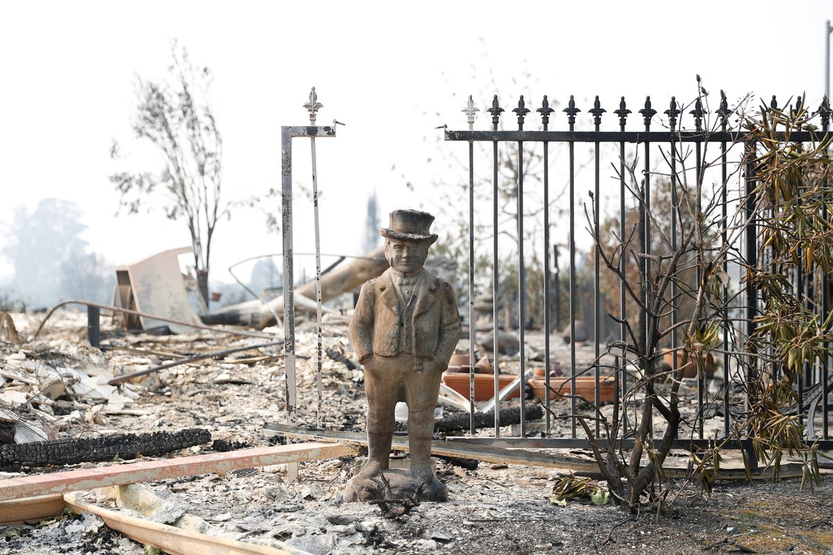 A statue stands amongst a home destroyed by the Tubbs Fire in Santa Rosa.REUTERS/Stephen Lam