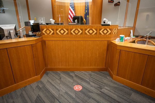 Physical distancing markers are placed on the floor and plexiglass barriers are erected in a courtroom at the Nesbett Courthouse on Wednesday, June 2, 2021 in Anchorage. (Loren Holmes / ADN)