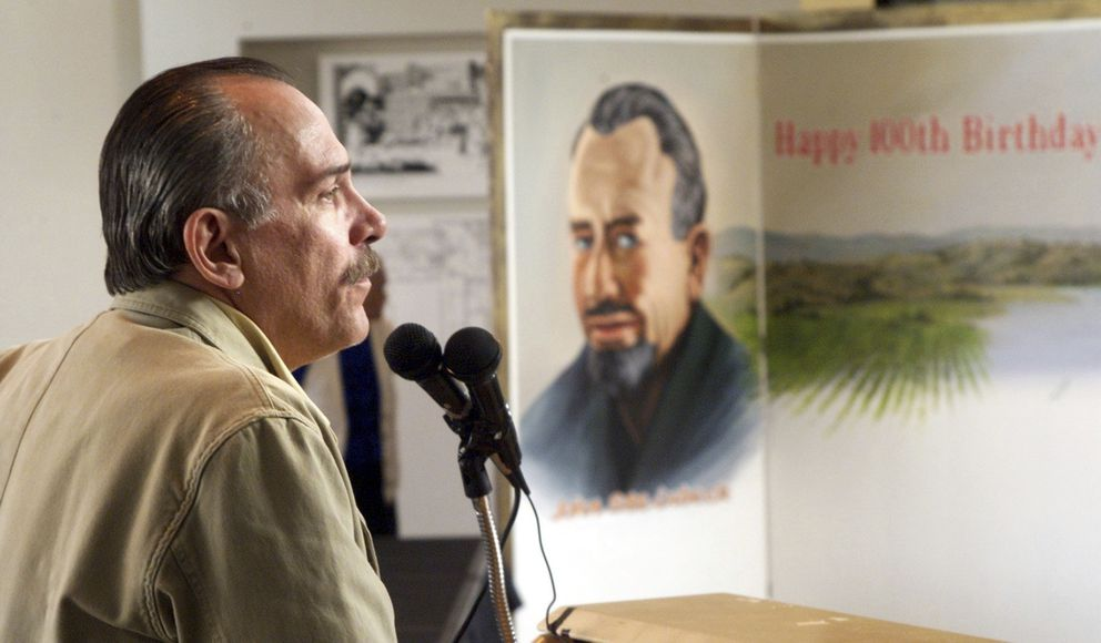FILE - In this Feb. 27, 2002 file photo, Thomas Steinbeck, son of author John Steinbeck, speaks to a crowd at the National Steinbeck Center in Salinas, Calif., to celebrate what would have been his father's 100th birthday. (Richard Green/The Californian, File)