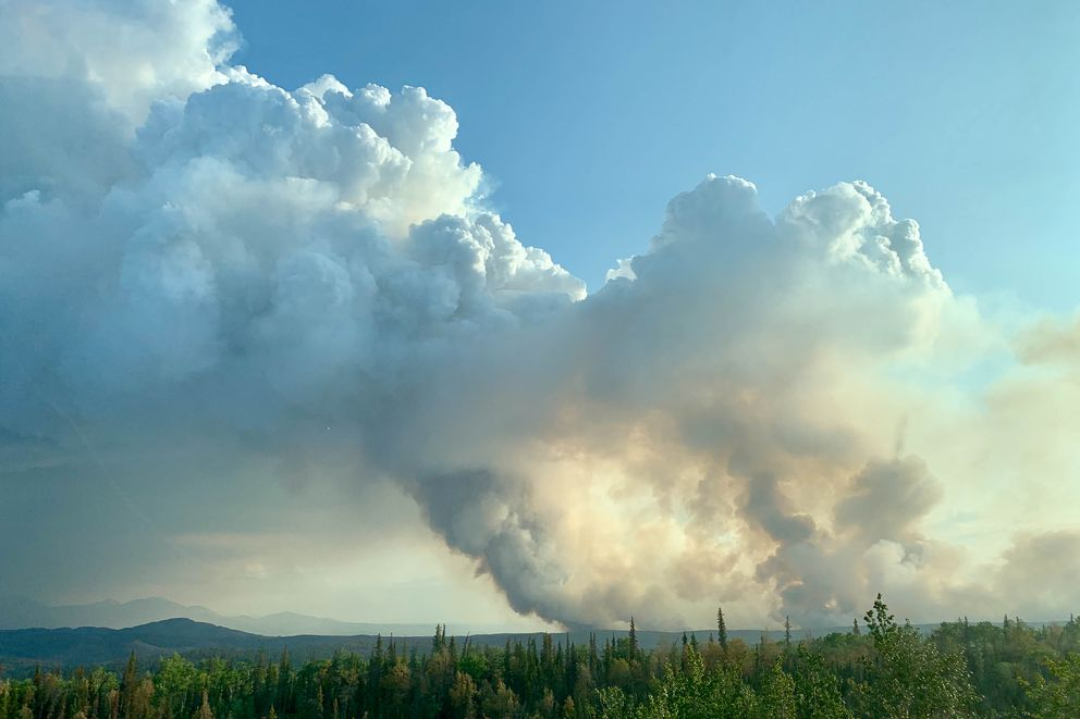 Smoke from the Swan Lake Fire rises over the Kenai Peninsula near Sterling, Alaska on Friday, Aug. 23, 2019. (Matt Tunseth / ADN)