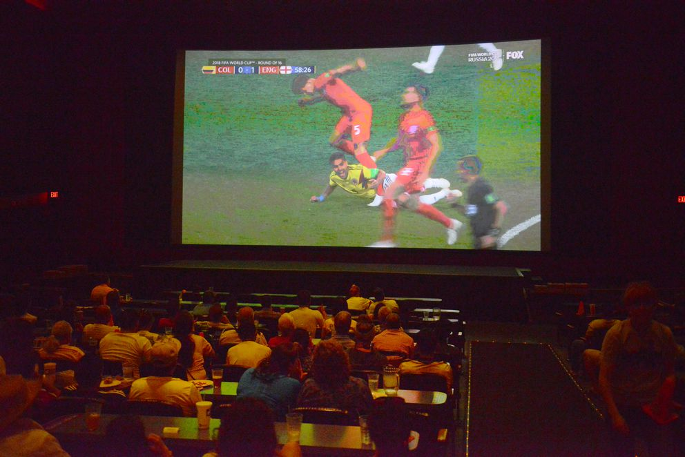 Fans watch the Colombia vs. England World Cup soccer match at the Bear Tooth Theatrepub. (Bob Hallinen / ADN)