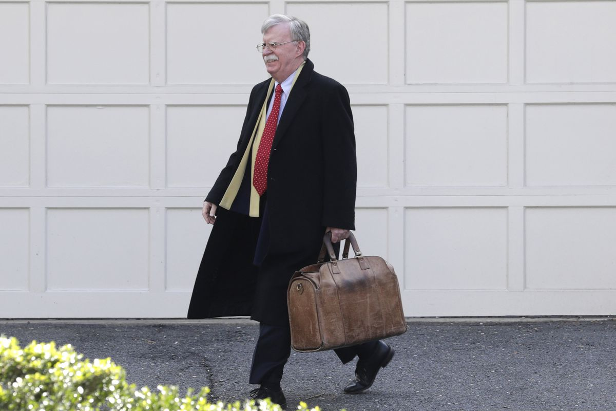Former National security adviser John Bolton leaves his home in Bethesda, Md. Tuesday, Jan. 28, 2020. President Donald Trump's legal team is raising a broad-based attack on the impeachment case against him even as it mostly brushes past allegations in a new book that could undercut a key defense argument at the Senate trial. Former national security adviser John Bolton writes in a manuscript that Trump wanted to withhold military aid from Ukraine until it committed to helping with investigations into Democratic rival Joe Biden.(AP Photo/Luis M. Alvarez)