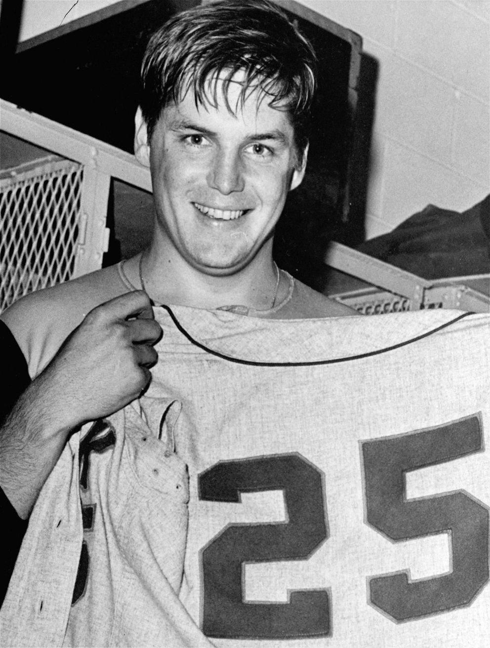 FILE - In this Sept. 27, 1969, file photo, New York Mets pitcher Tom Seaver holds up a No. 25 Mets uniform after winning his 25th victory of the year, against the Philadelphia Phillies in Philadelphia. (AP Photo, File)