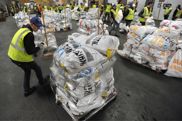 Iditarod volunteer Tucker Anderson, a missionary with the Church of Latter-Day Saints, wraps a pallet of drop bags destined for White Mountain as the first group of mushers delivered their drop bags at Air Land Transport in Anchorage on Wednesday, Feb. 13, 2019. The drop bags consisting of food for the mushers and their dogs along with various supplies including booties will be delivered to specific checkpoints along the trail in advance of the 2019 Iditarod Trail Sled Dog Race that begins with a ceremonial start in Anchorage on Saturday, Mar. 2, and the Restart in Willow on Sunday, Mar. 3. (Bill Roth / ADN)