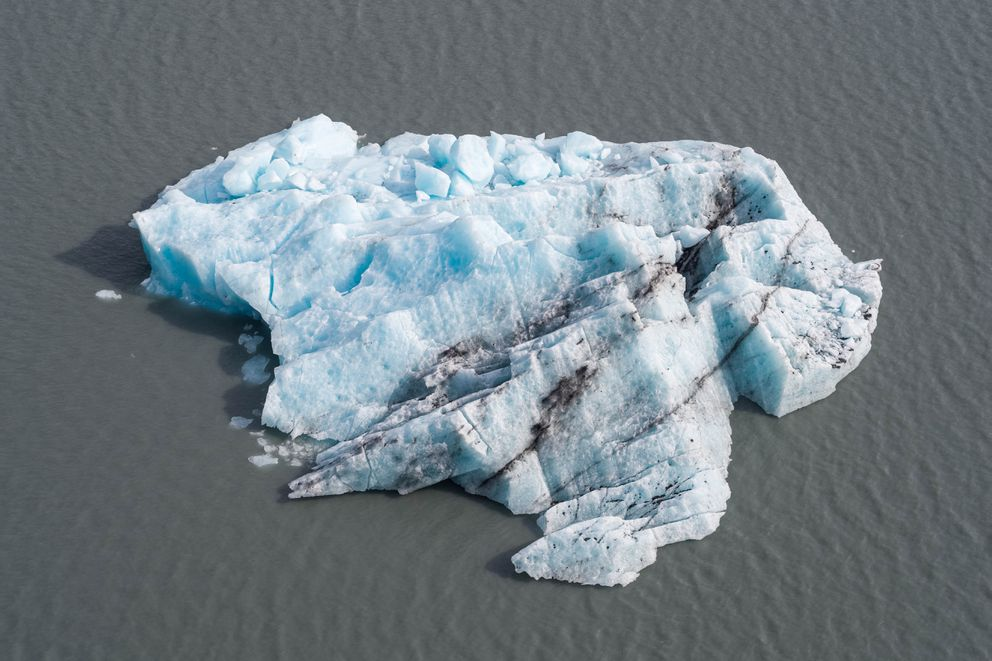 One of two large icebergs floats in Portage Lake Wednesday, Aug. 14, 2019. The icebergs recently calved from Portage Glacier. (Loren Holmes / ADN)