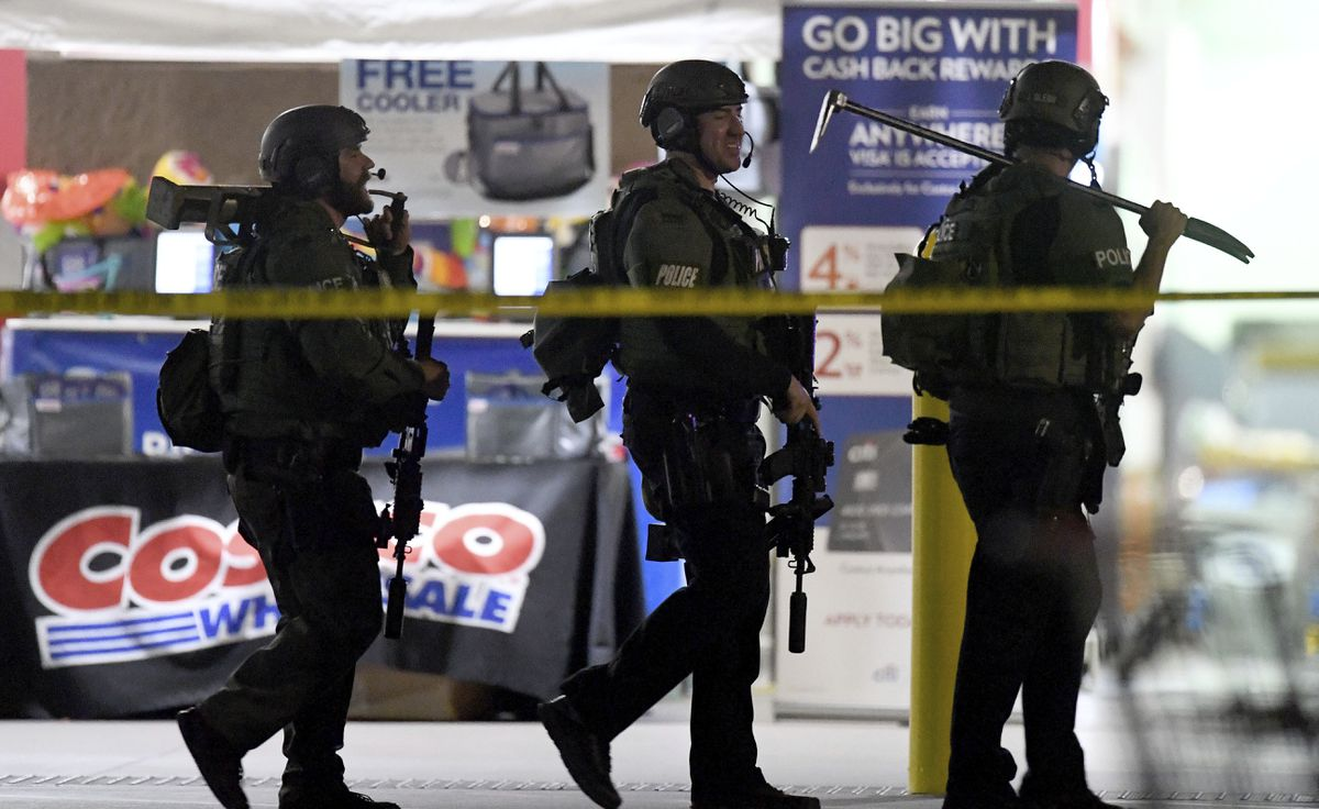 Heavily armed police officers exit the Costco following a shooting inside the wholesale warehouse in Corona, Calif., Friday, June 14, 2019. A gunman opened fire inside the store during an argument, killing a man, wounding two other people and sparking a stampede of terrified shoppers before he was taken into custody, police said. The man involved in the argument was killed and two other people were wounded, Corona police Lt. Jeff Edwards said. (Will Lester/Inland Valley Daily Bulletin/SCNG via AP)