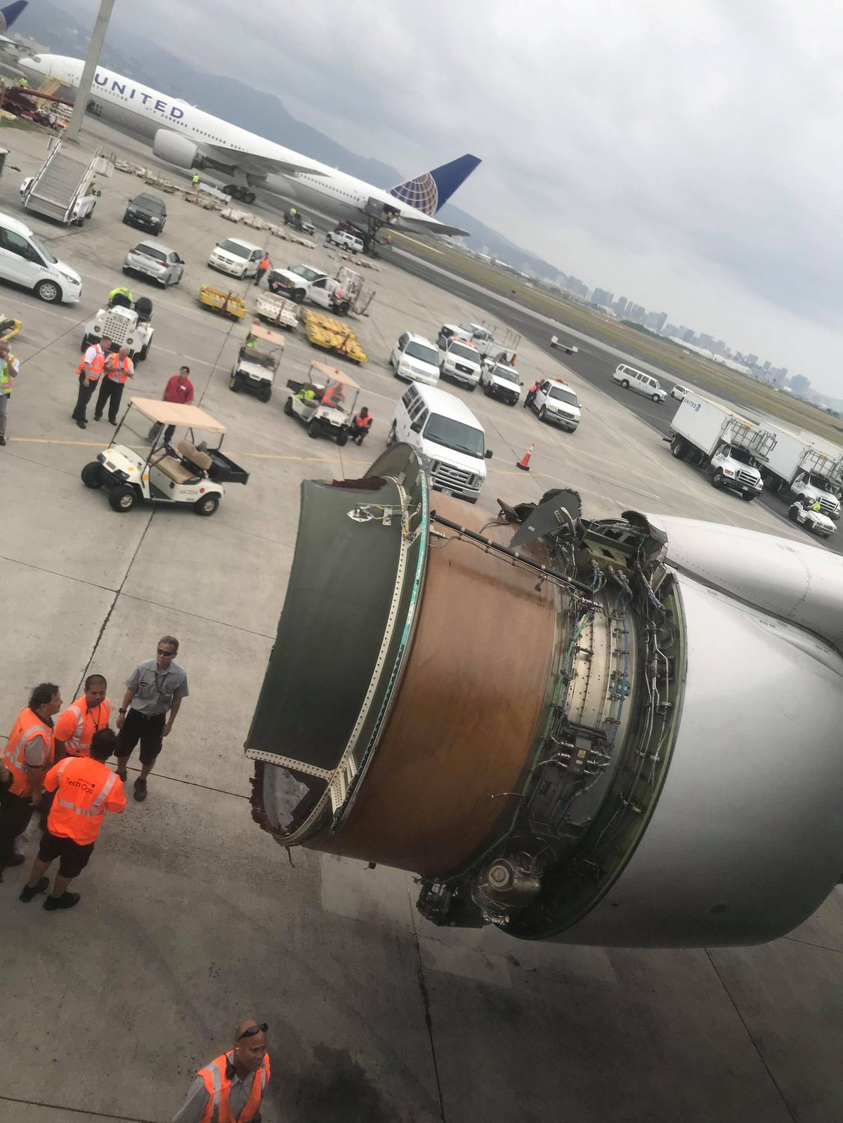 The plane with engine problems on the tarmac Tuesday in Honolulu in this picture obtained from social media. Mariah Amerine/via REUTERS